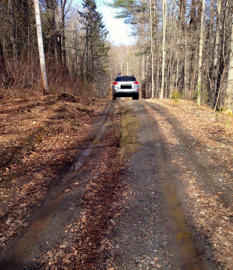 one of their two Vermont-ready new-to-them cars, the Outback, navigating their 1/4 mile driveway